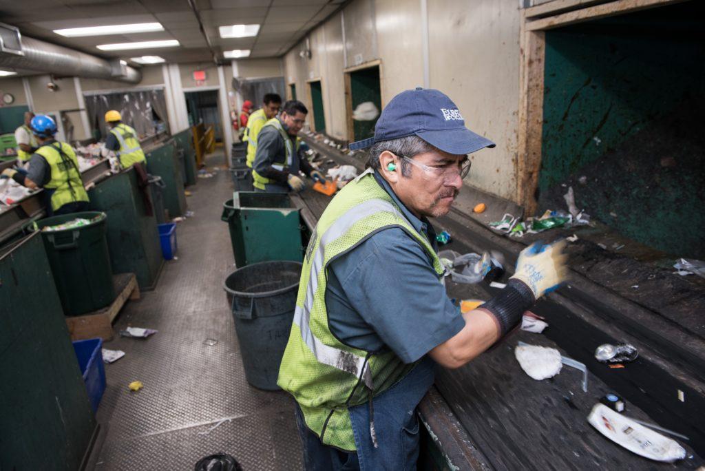 Eureka staffers sorting waste.