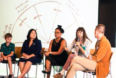 Group of people speak on a panel.